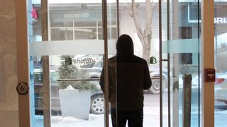 person-walking-through-automatic-door